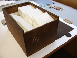 Conserved medieval deeds put into paper envelopes and then back in their box