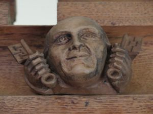 An image of a wooden carving in the form of Mike Strutt