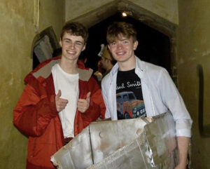Ryan is stood in a passageway with his friend, they have fancy dress on and look happy. Read Ryan's profile for more information.