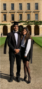 Parth is stood in front of the New Building in Magdalen wearing an Oxford gown with a girl also wearing an Oxford gown. Read more about Parth in his profile.