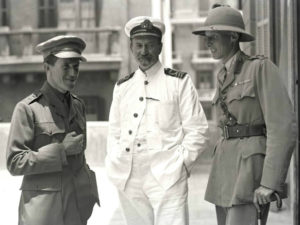 D. G. Hogarth with T. E. Lawrence and Lt. Col. Dawnay at the Arab Bureau in Cairo, 1918. Credit: Lowell Thomas (photographer), Public domain, via Wikimedia Commons